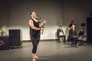 Amber Sinclair plays the bagpipes.  Photograph by Aldona Kmeic.